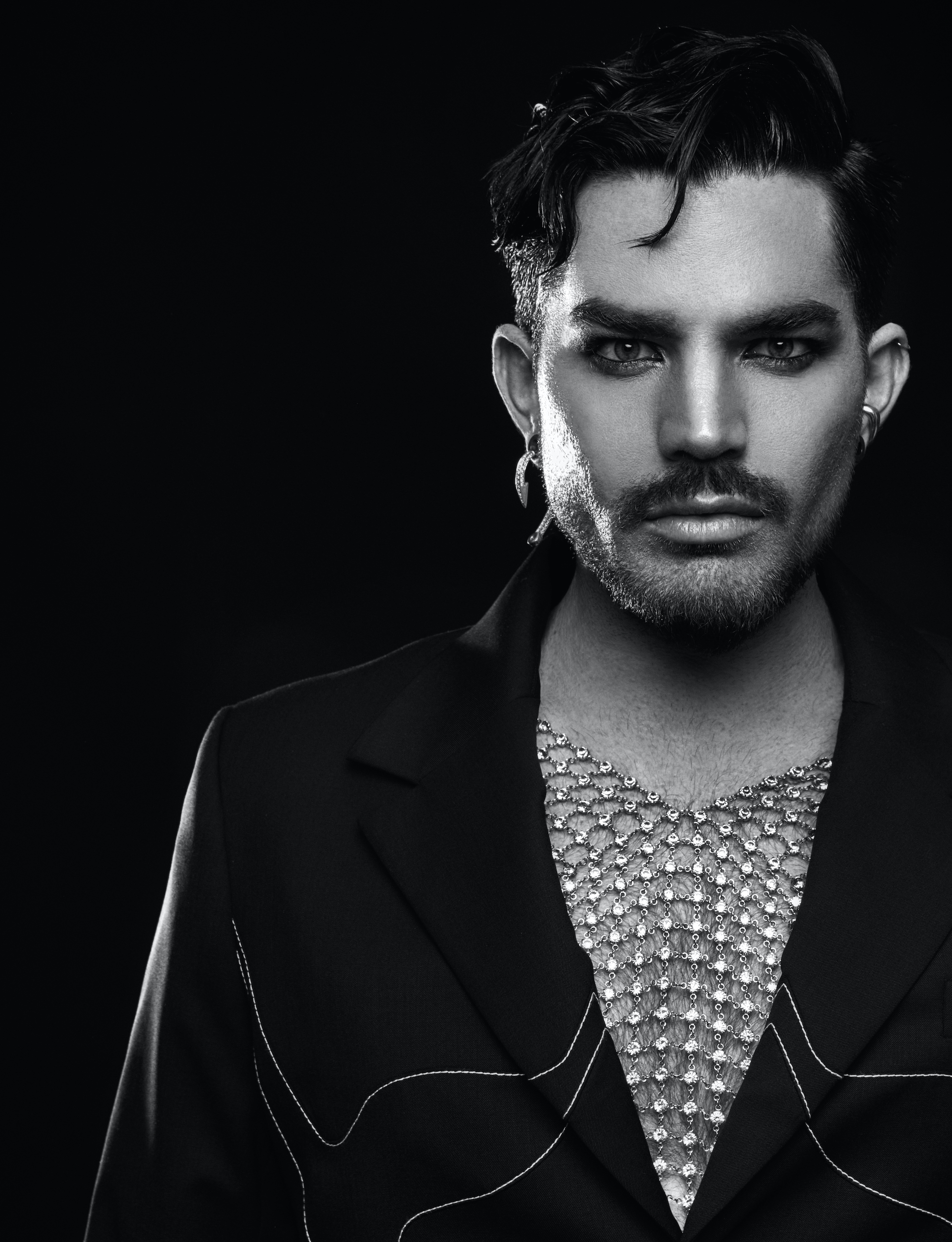 Adam Lambert fronts the cover of Rollacoaster SS20 issue in a chain mail top