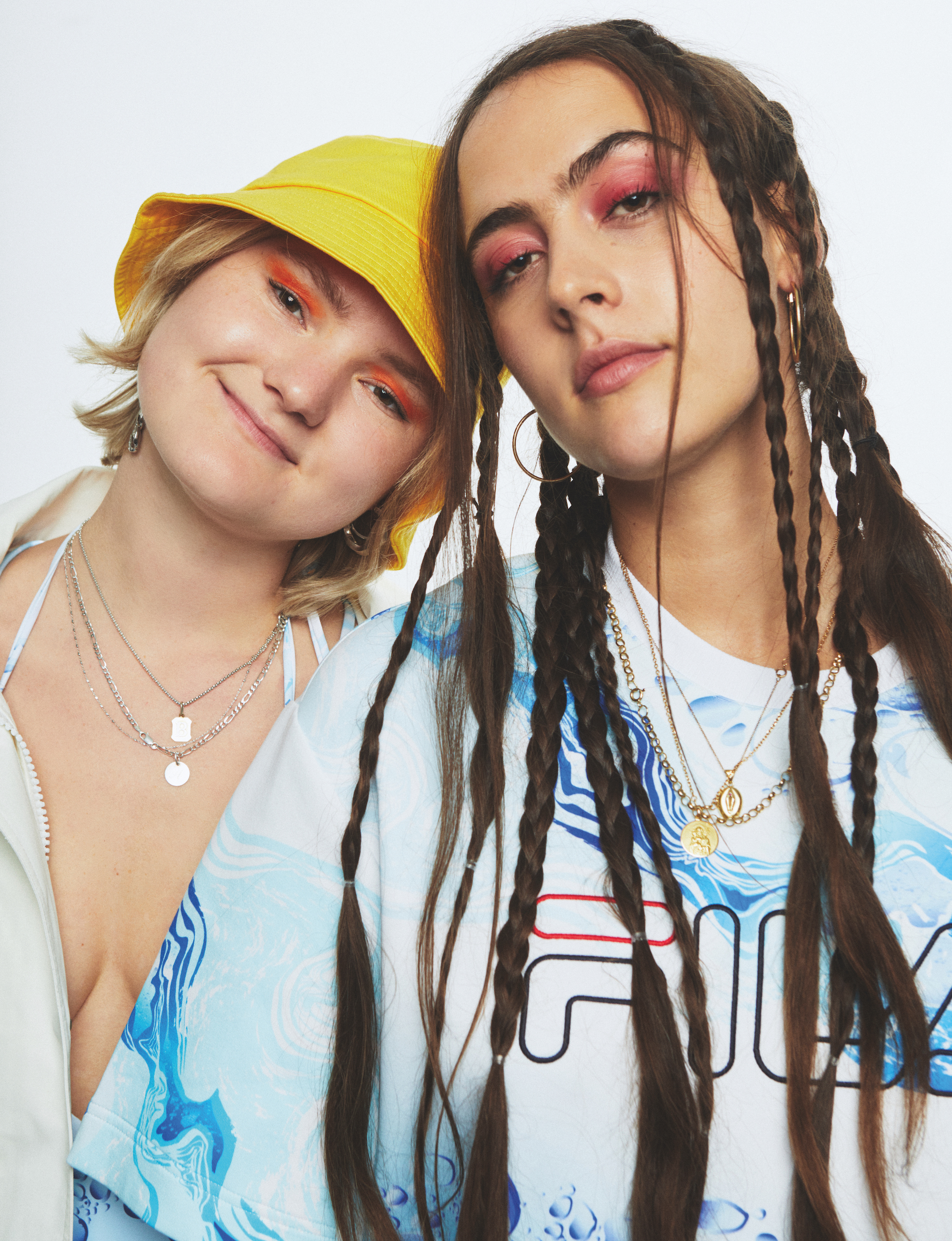 Hinds wearing yellow hate and braided hair