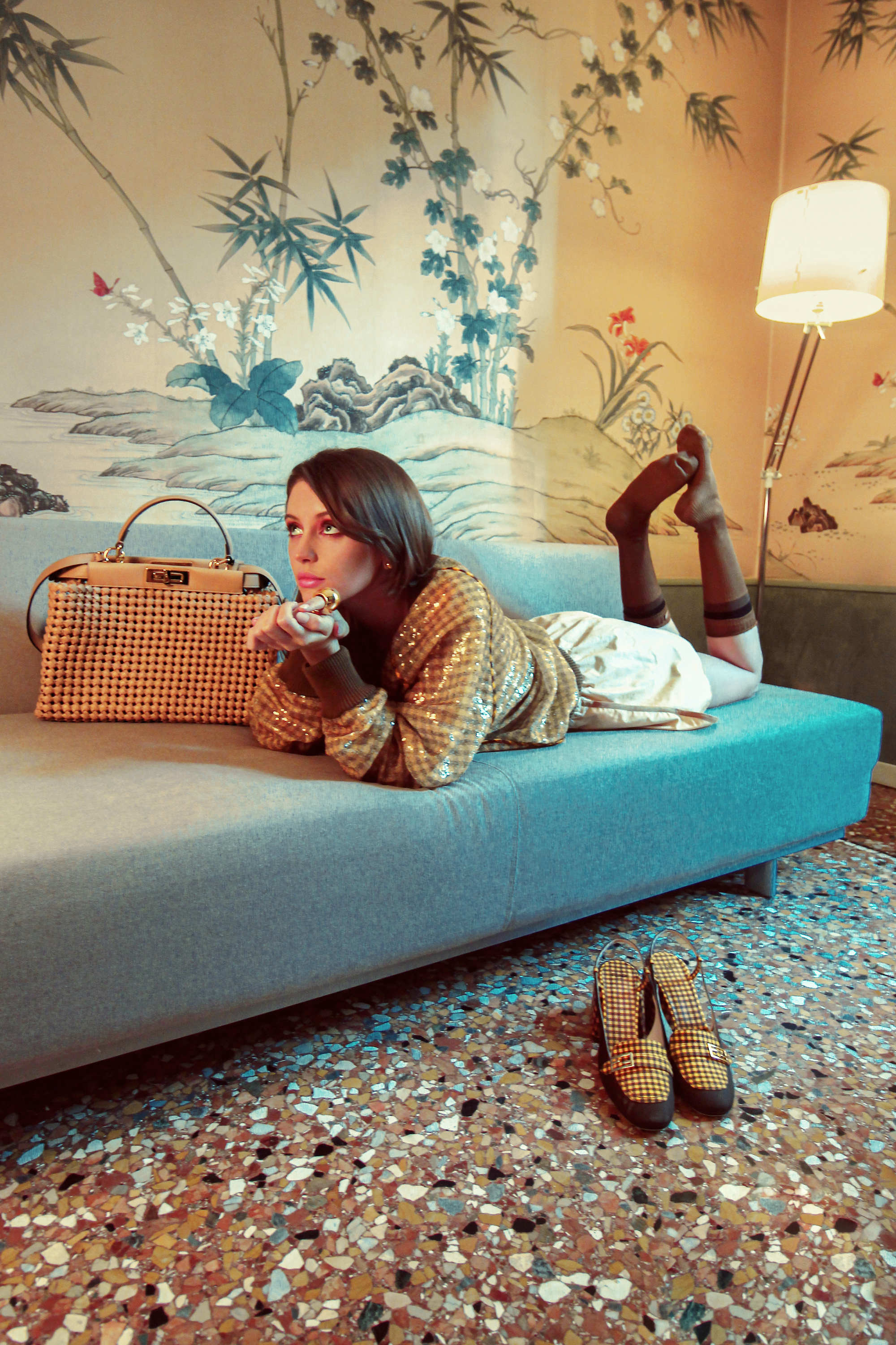 Iris law laying on a blue sofa