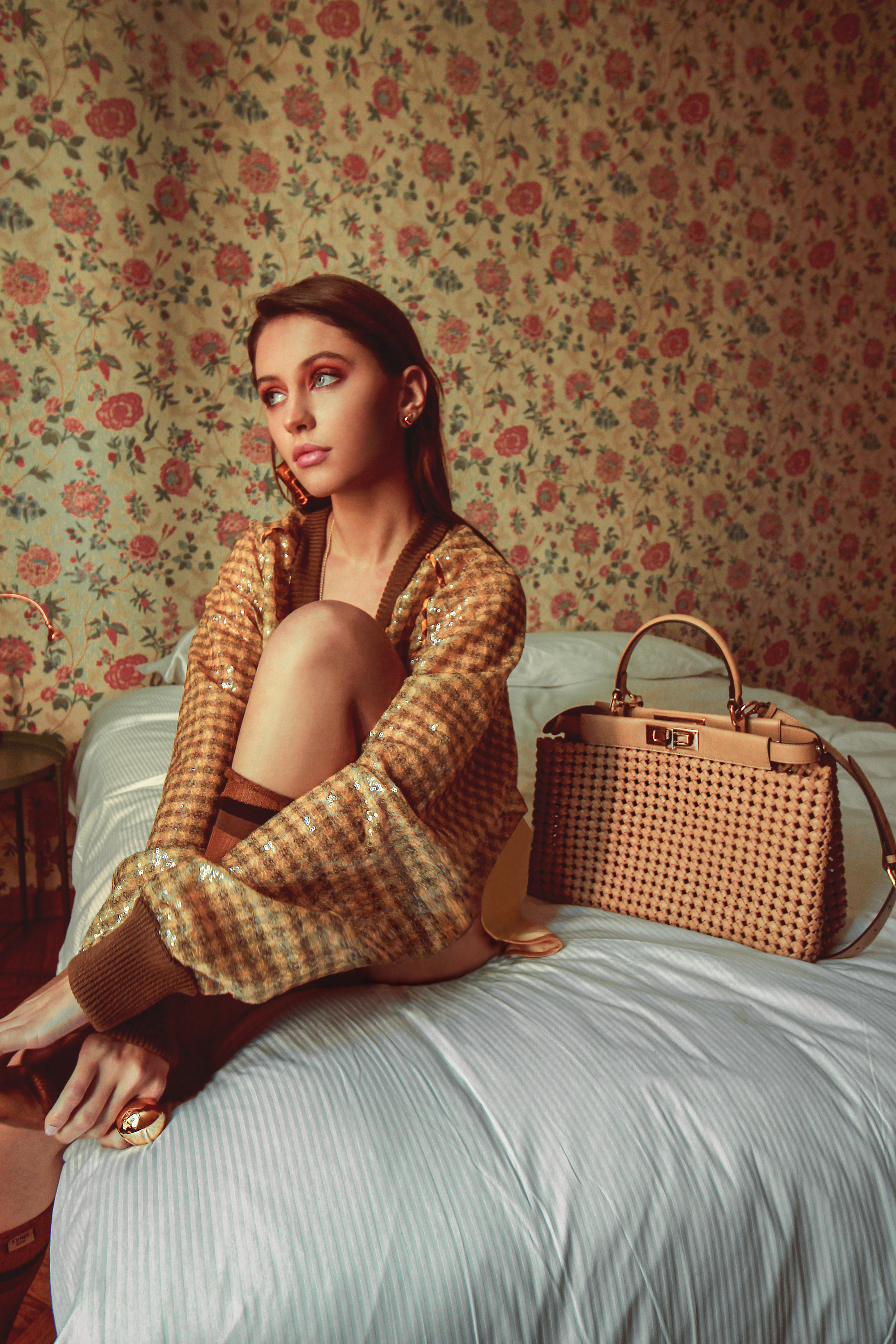 Iris law wearin brown jumper next to fendi bag