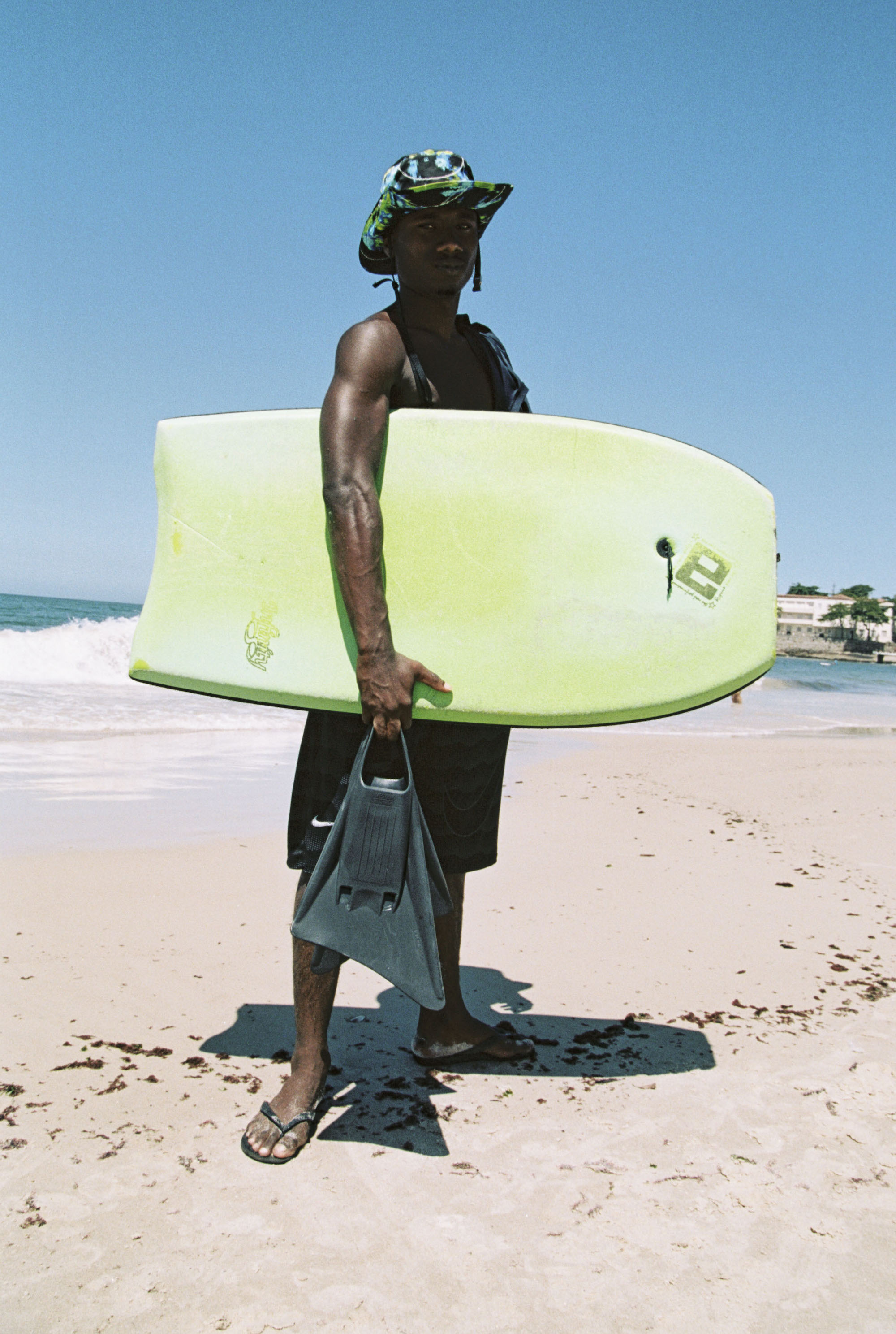 Cariocas Black guy with surf board on beach