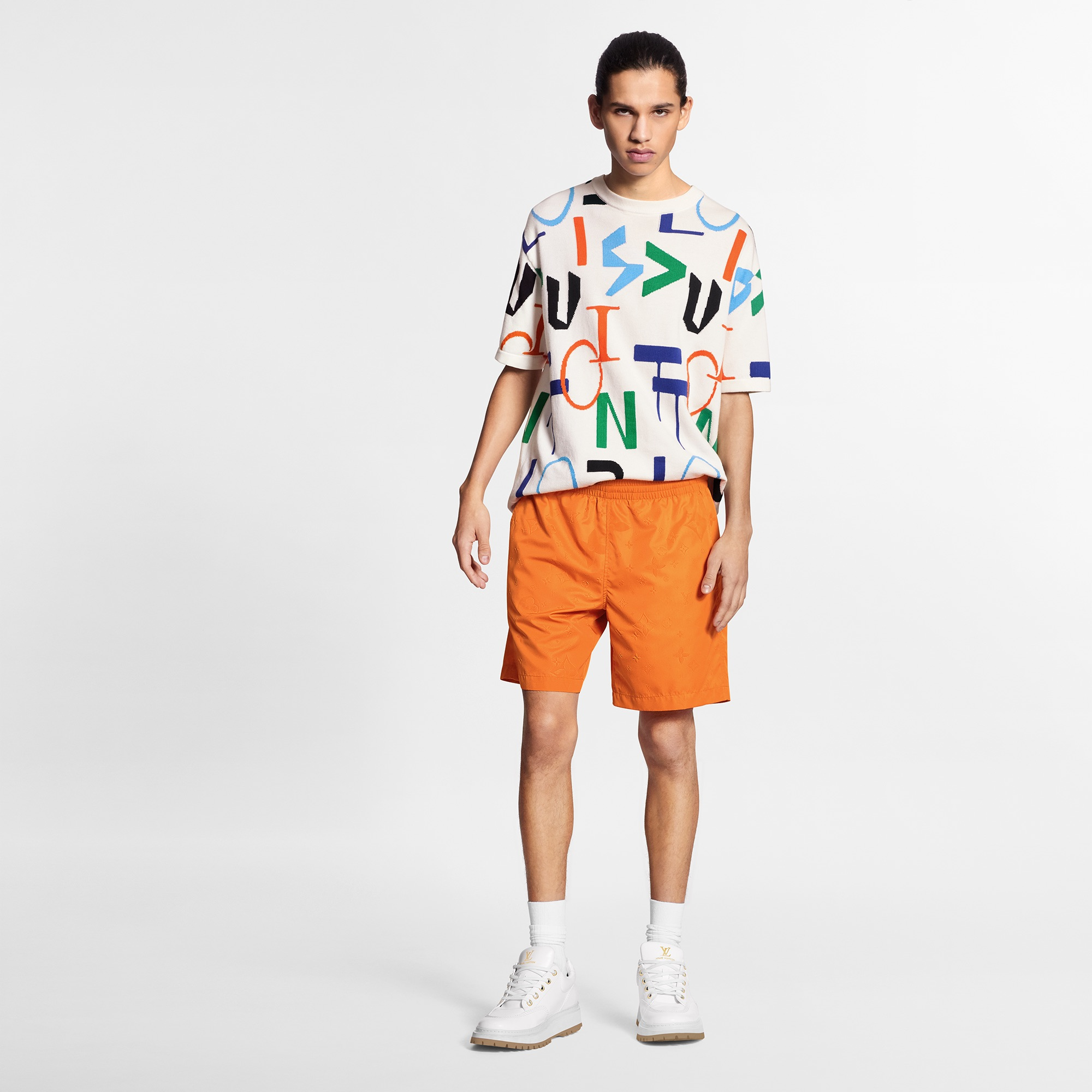 Louis Vuitton orange short and geometric t-shirt