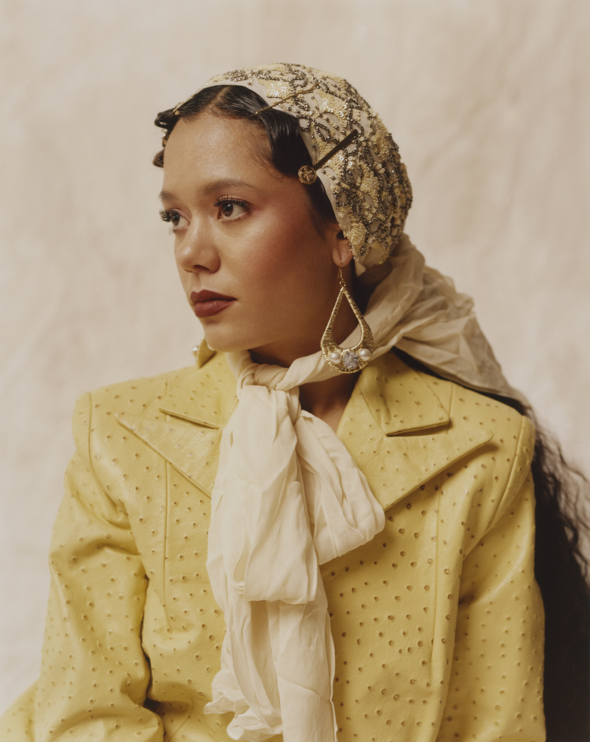 Tara Lily in yellow scarf and jacket