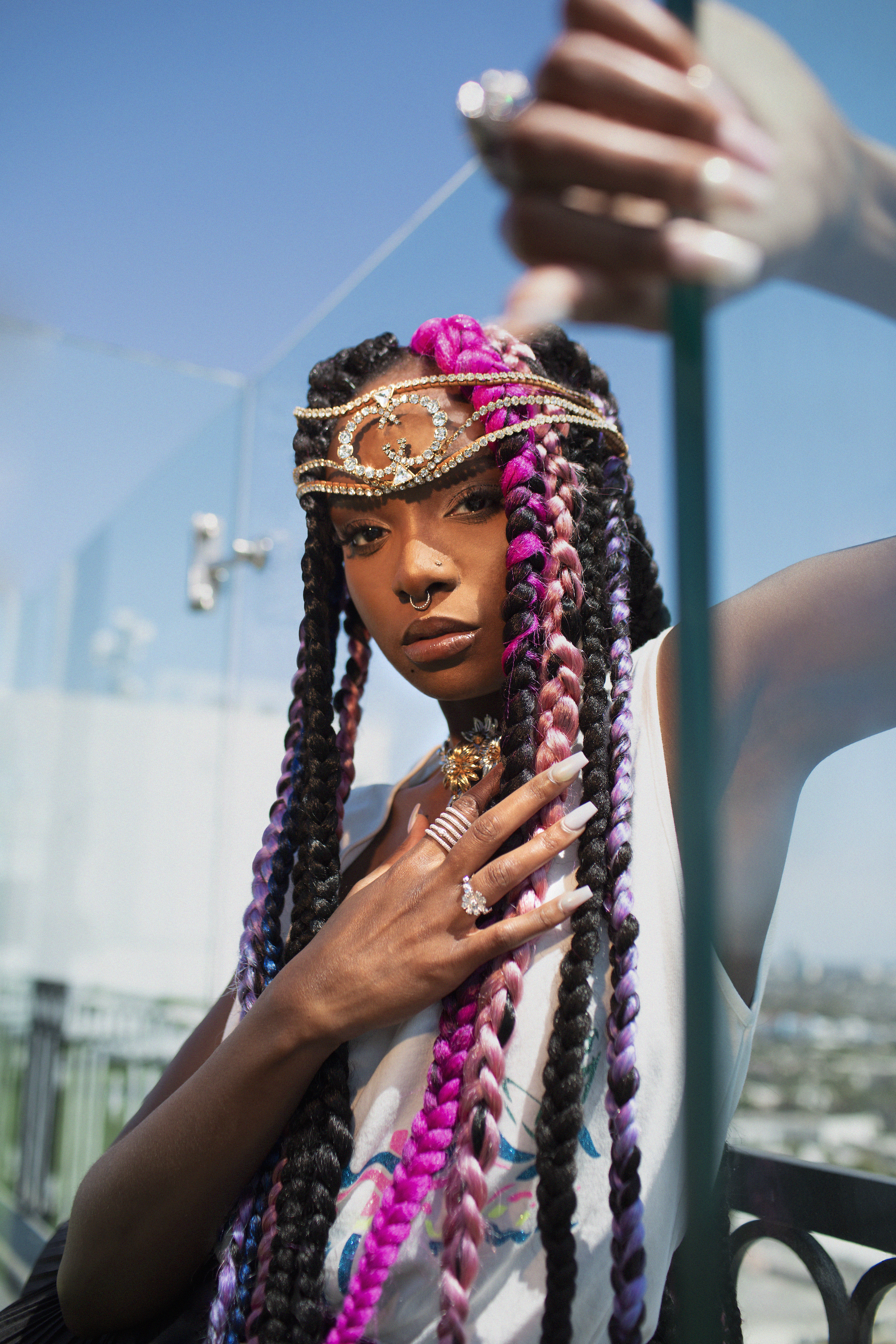 Kiki layne with purple and pink braids and gold headpiece