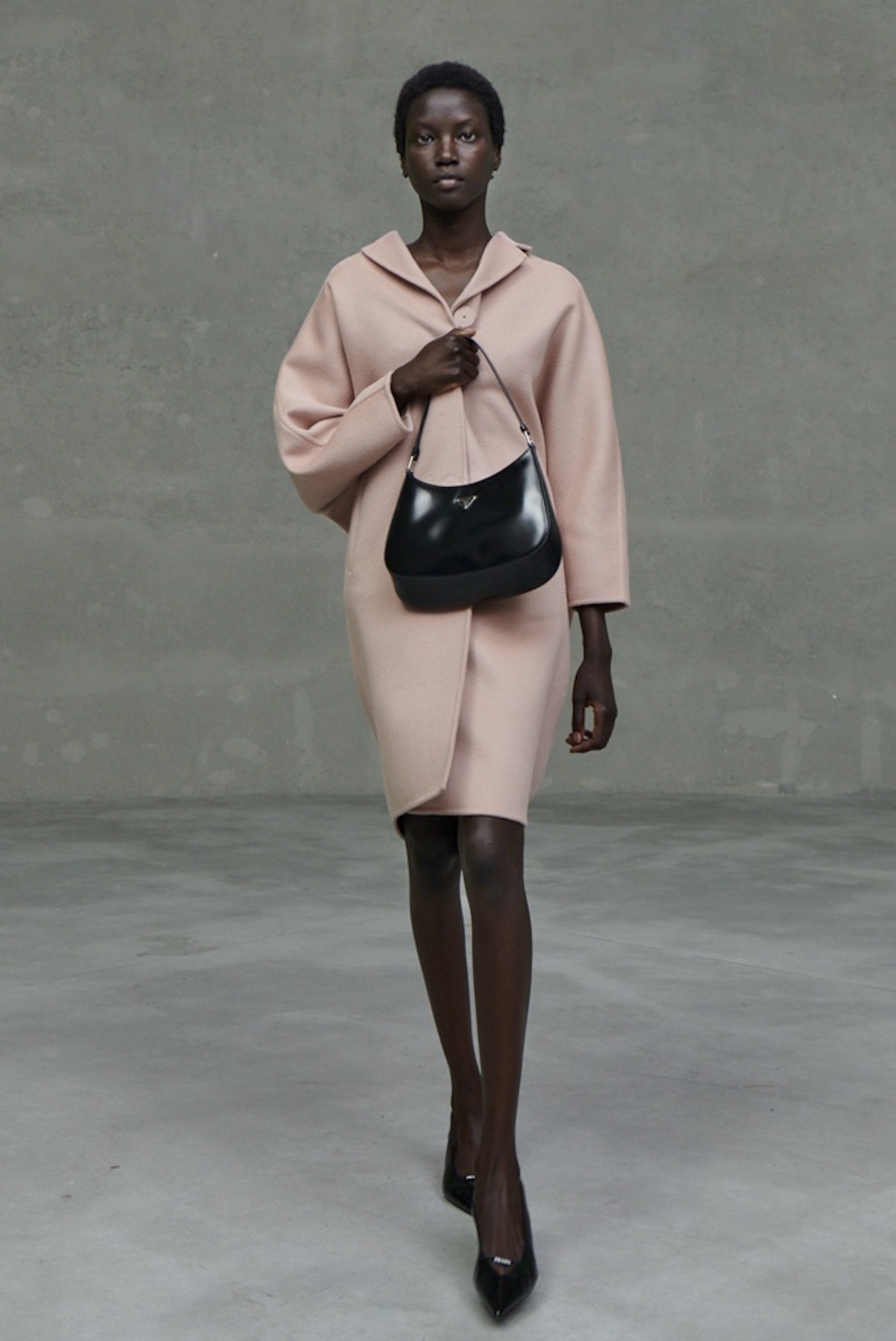 Prada SS21 collection pink coat with black bag