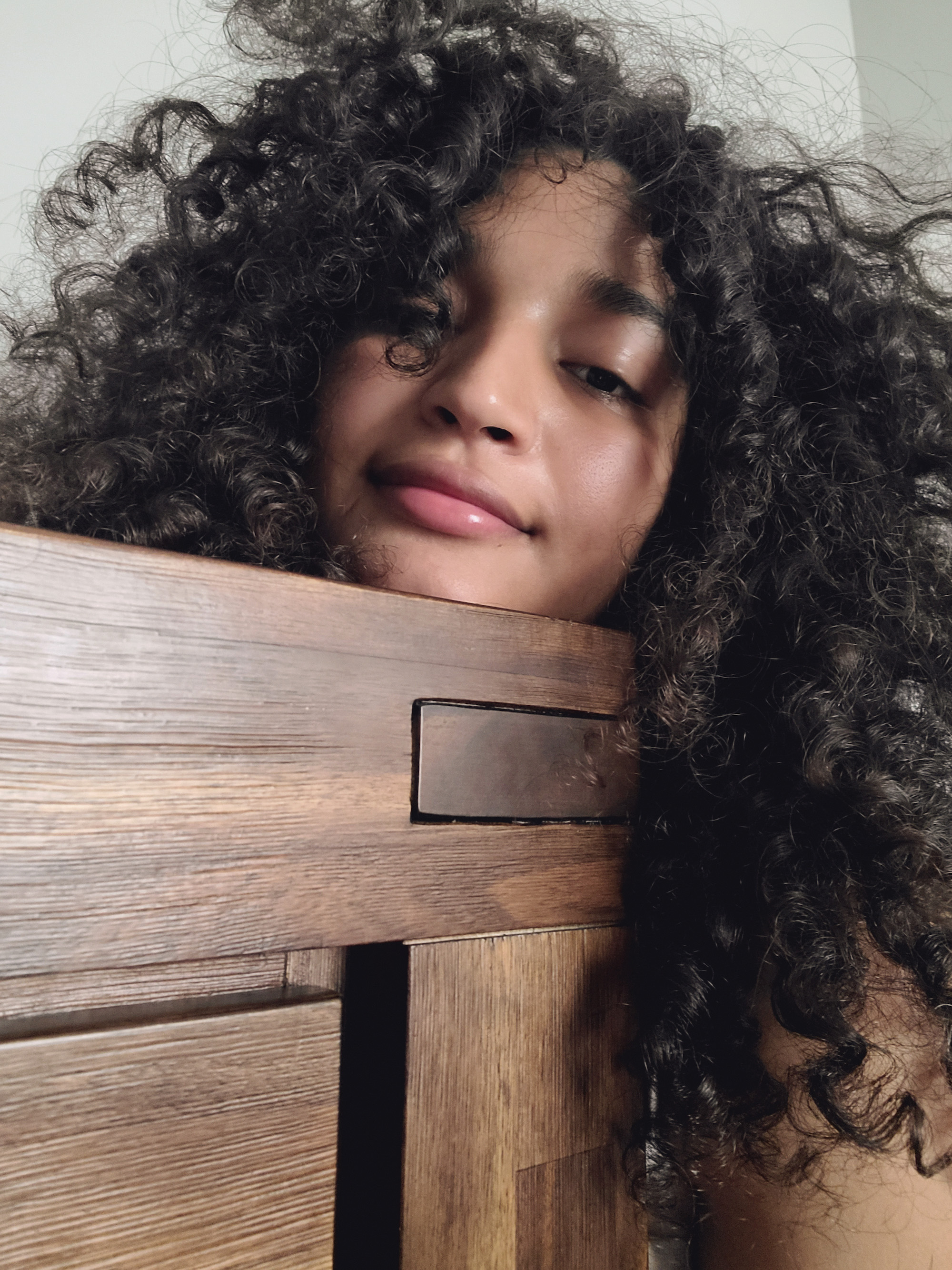 Indya Moore close up curly hair
