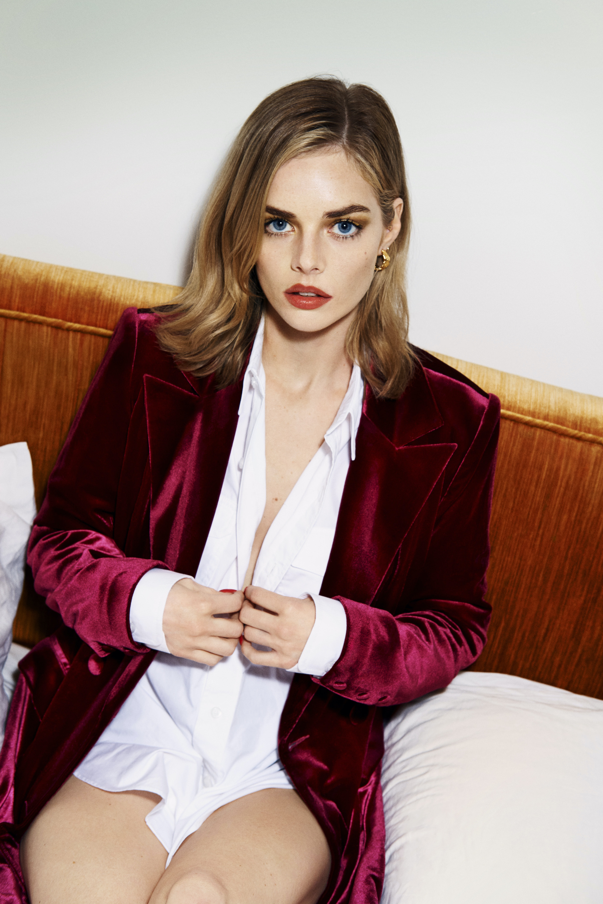 Samara weaving in white shirt and red jacket