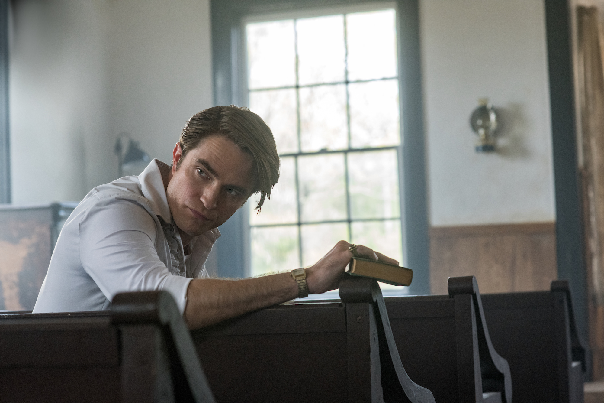 The Devil All The Time: Robert Pattinson as Preston Teagardin. Photo Cr. Glen Wilson/Netflix © 2020