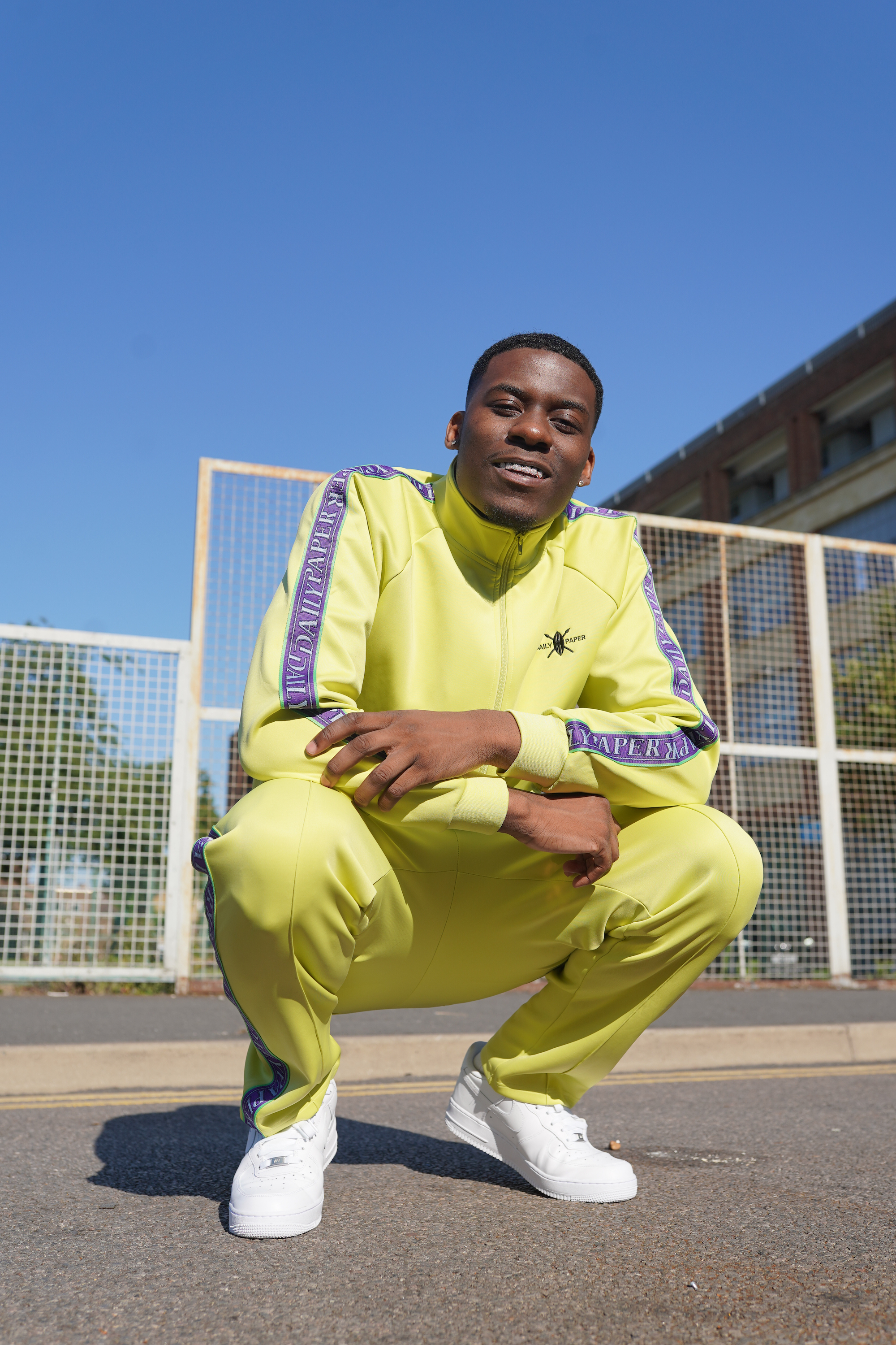 JAY1 in bright neon tracksuit