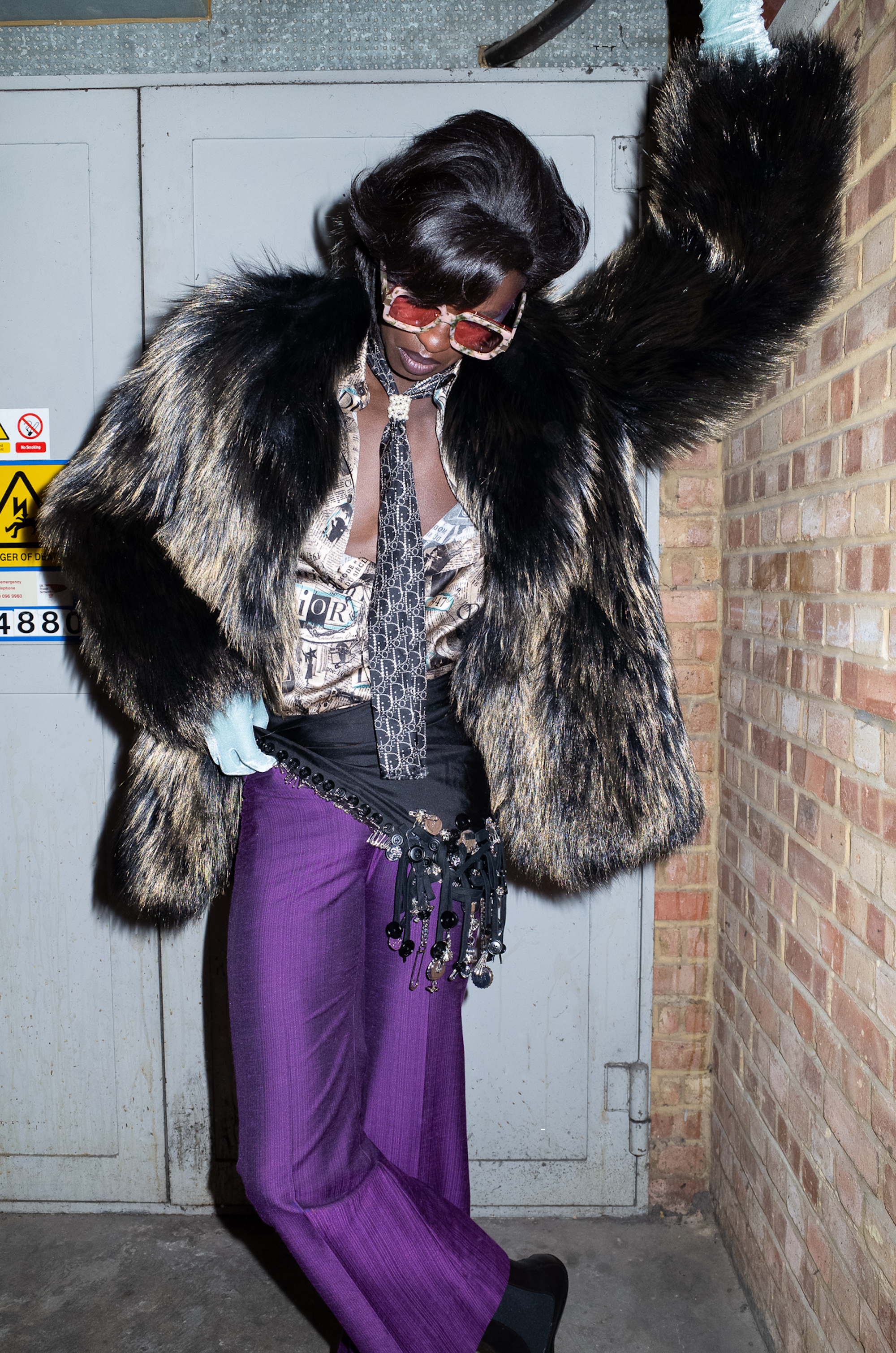 Fashion editorial purple trousers and black fur jacket
