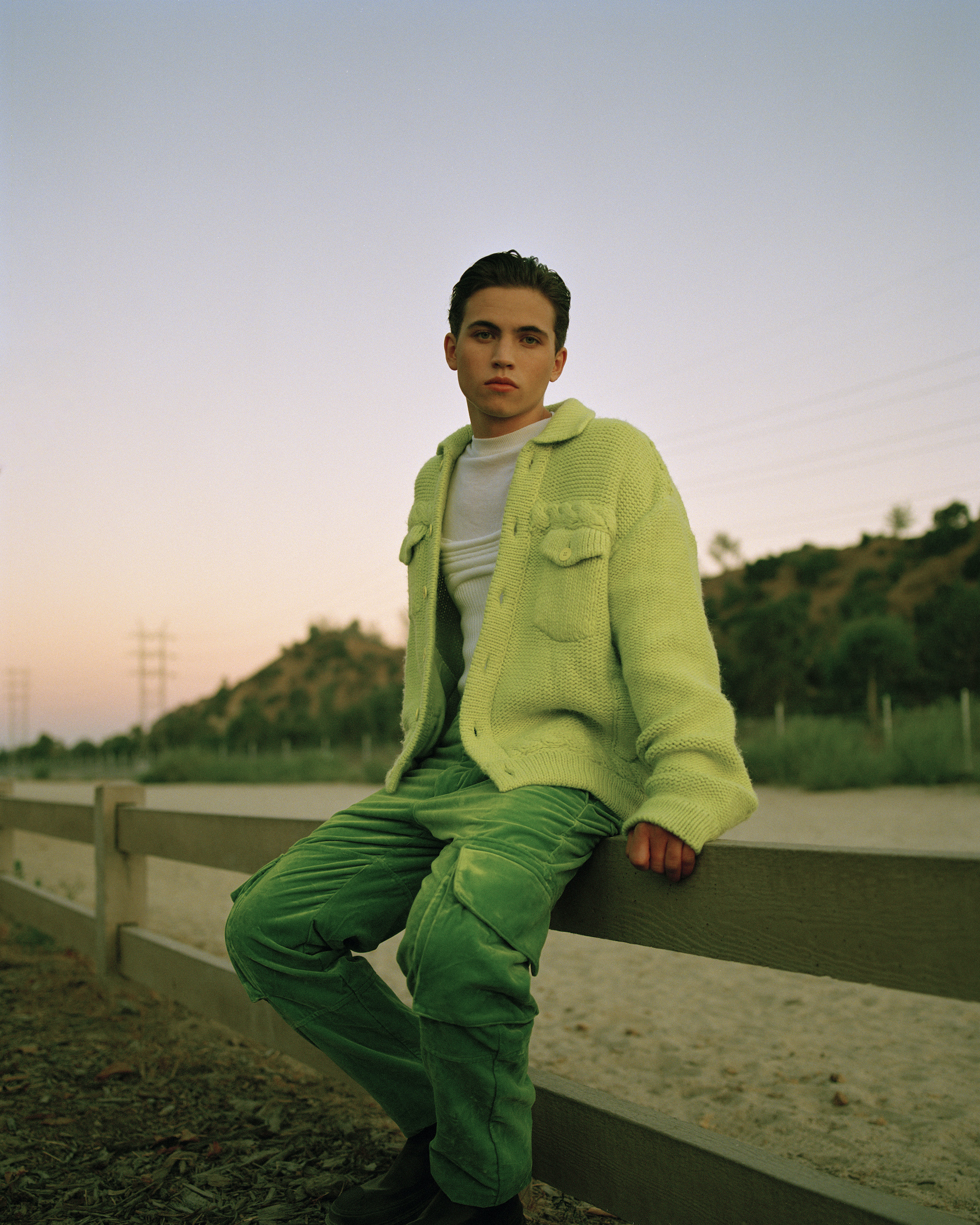 Tanner wearing green jacket and trousers