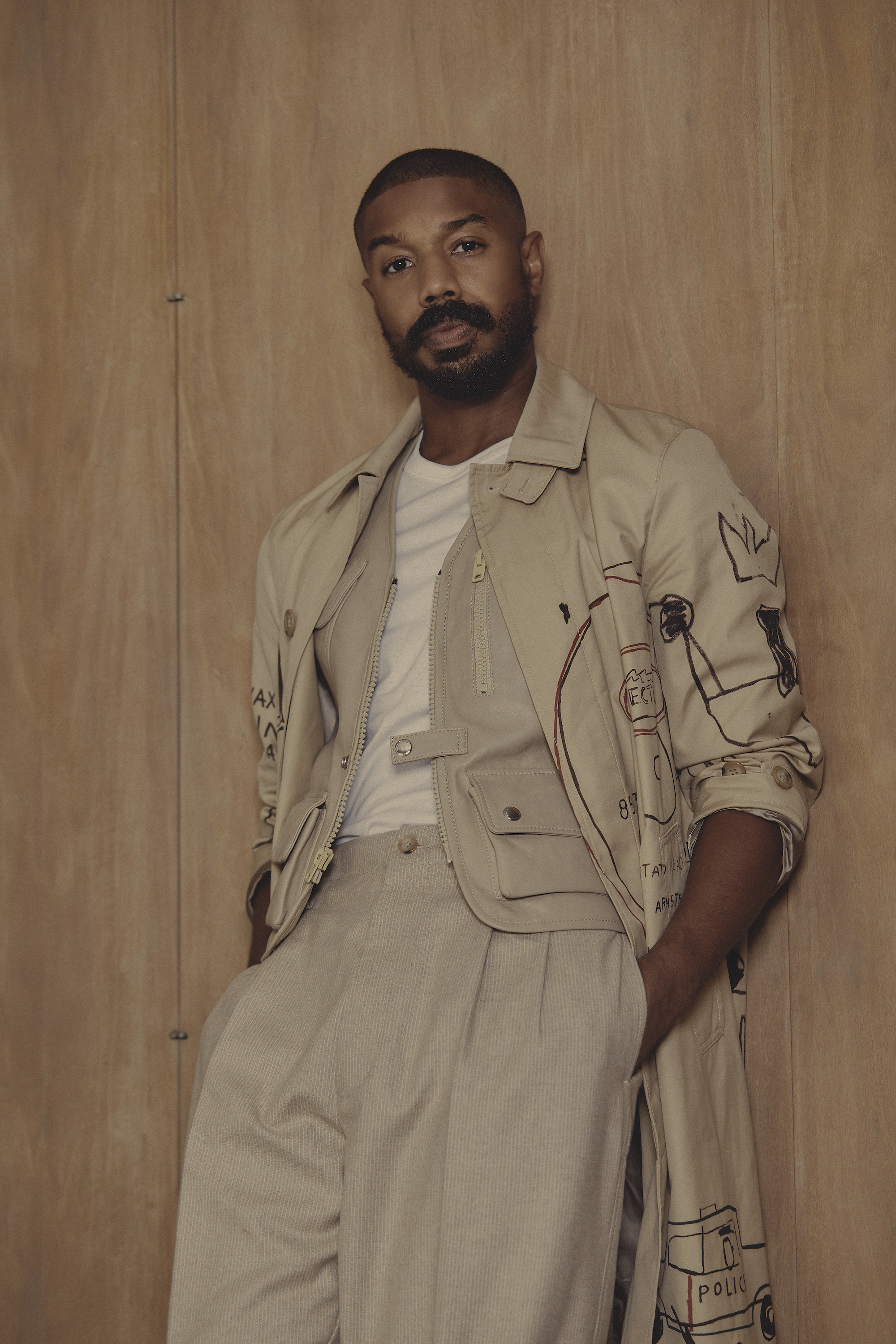 Michael B Jordan wearing beige COACH coat and trousers for the Autumn 2020 issue of Wonderland