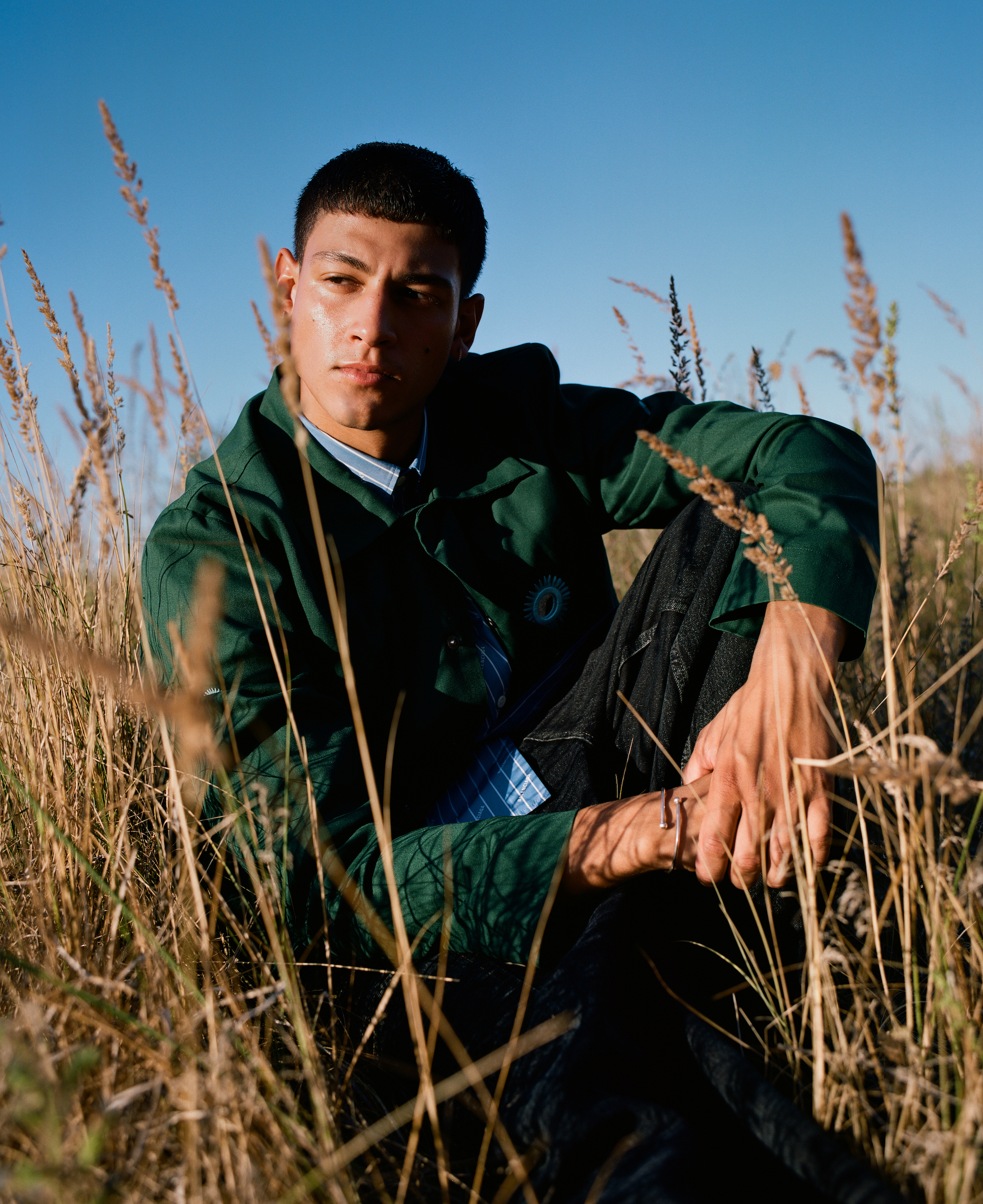 Emilio Sakraya wearings green jacket sitting down