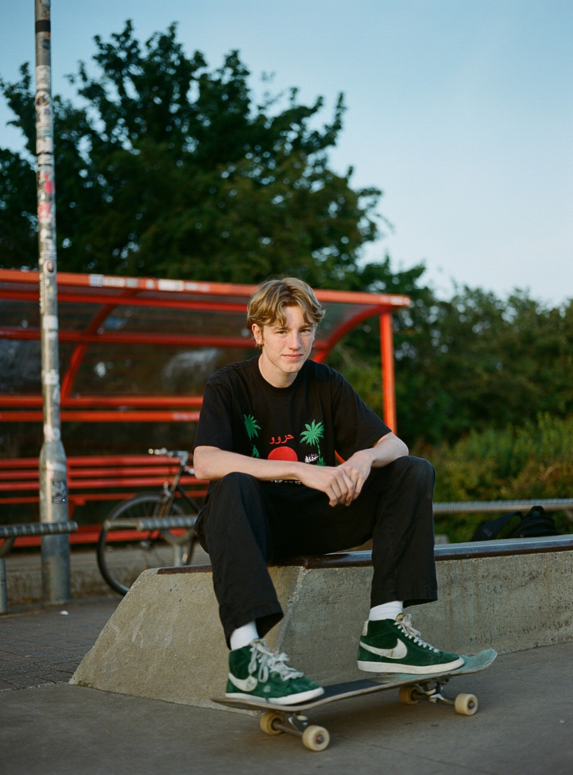 Sam Elstub analog photographer, skater, young skateboarder in colourful tee and nikes
