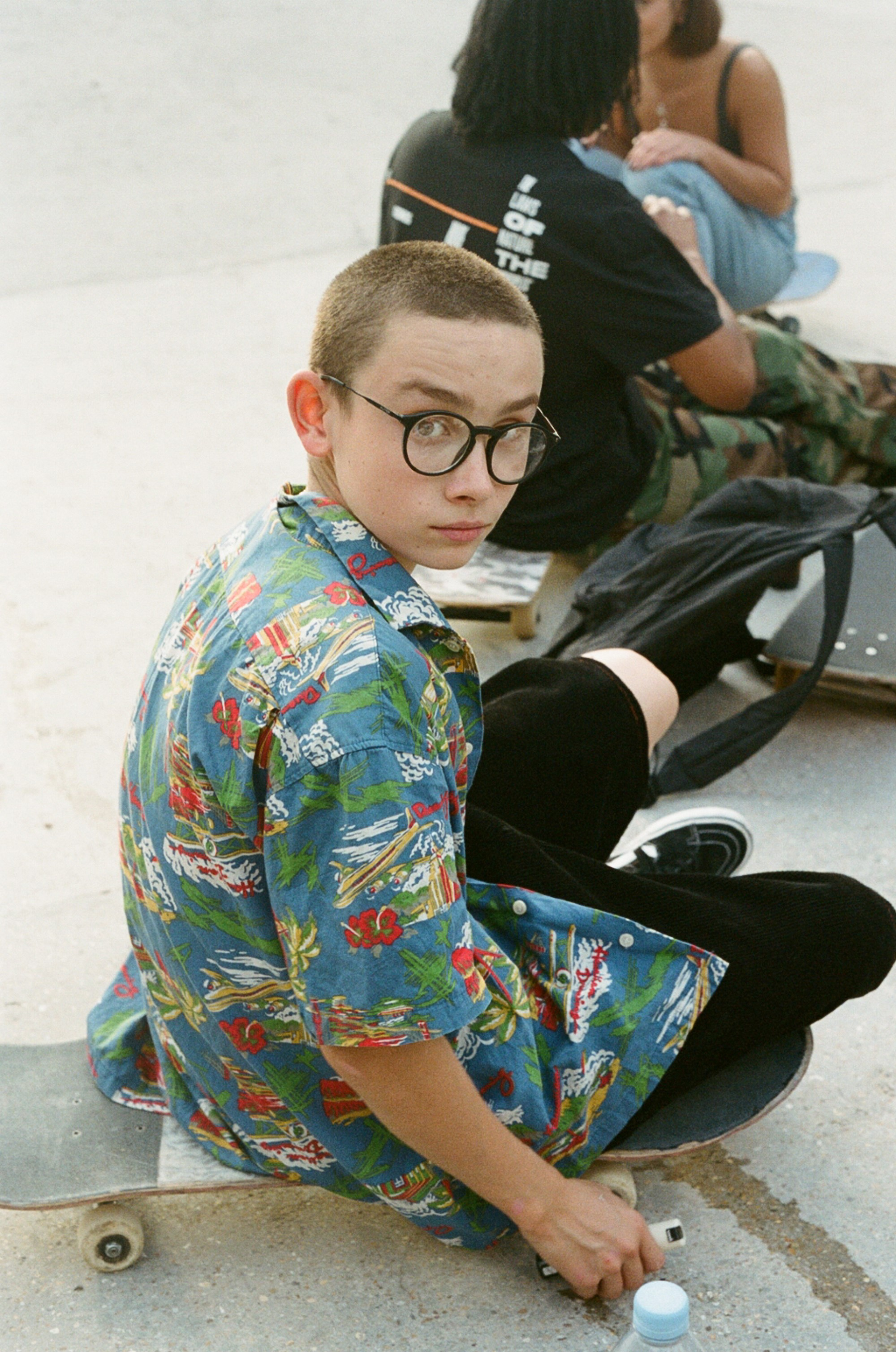 Sam Elstub analog photographer, skater, young skateboarder in blue red patterned shirt and glasses