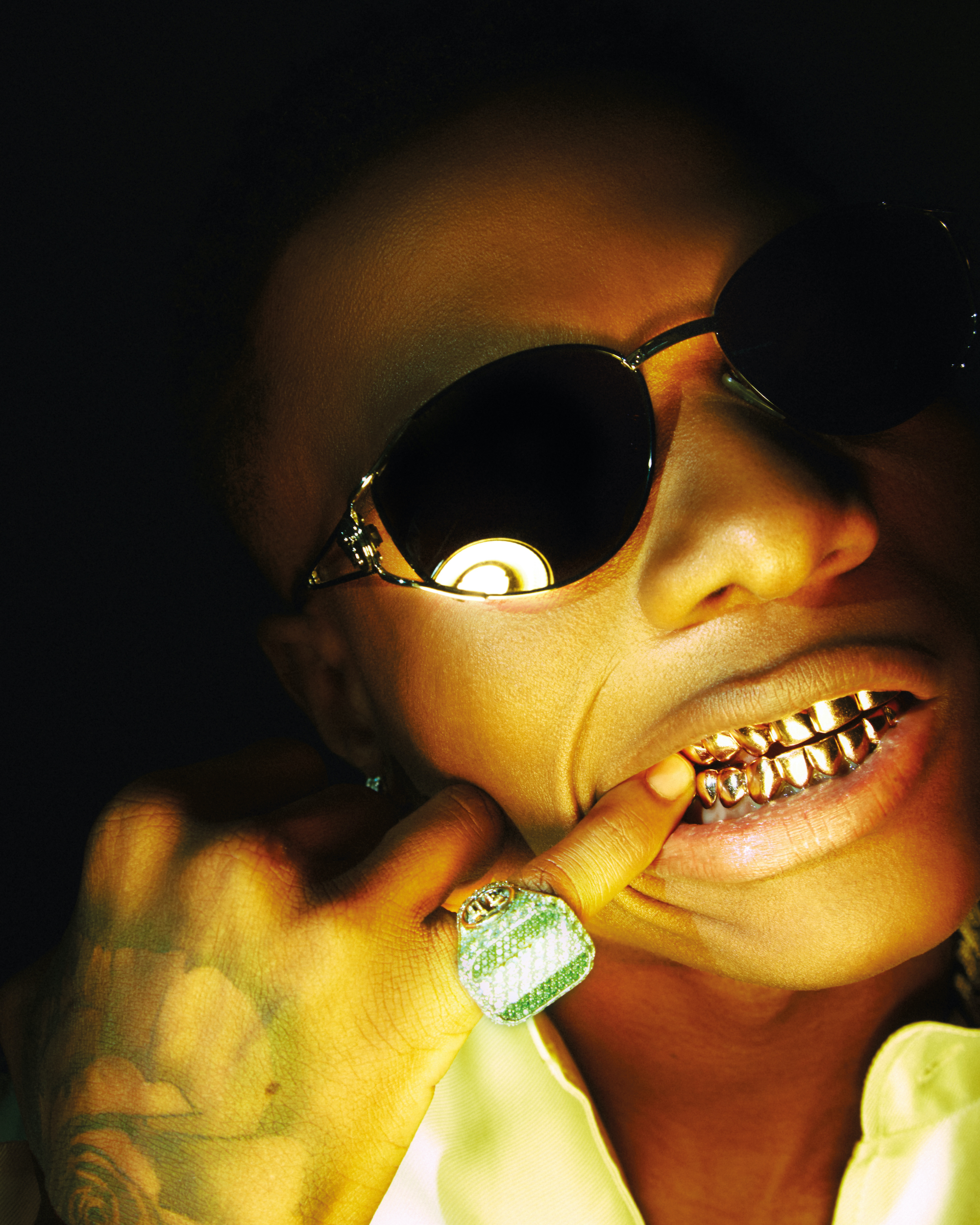 WizKid wearing shades and gold ring