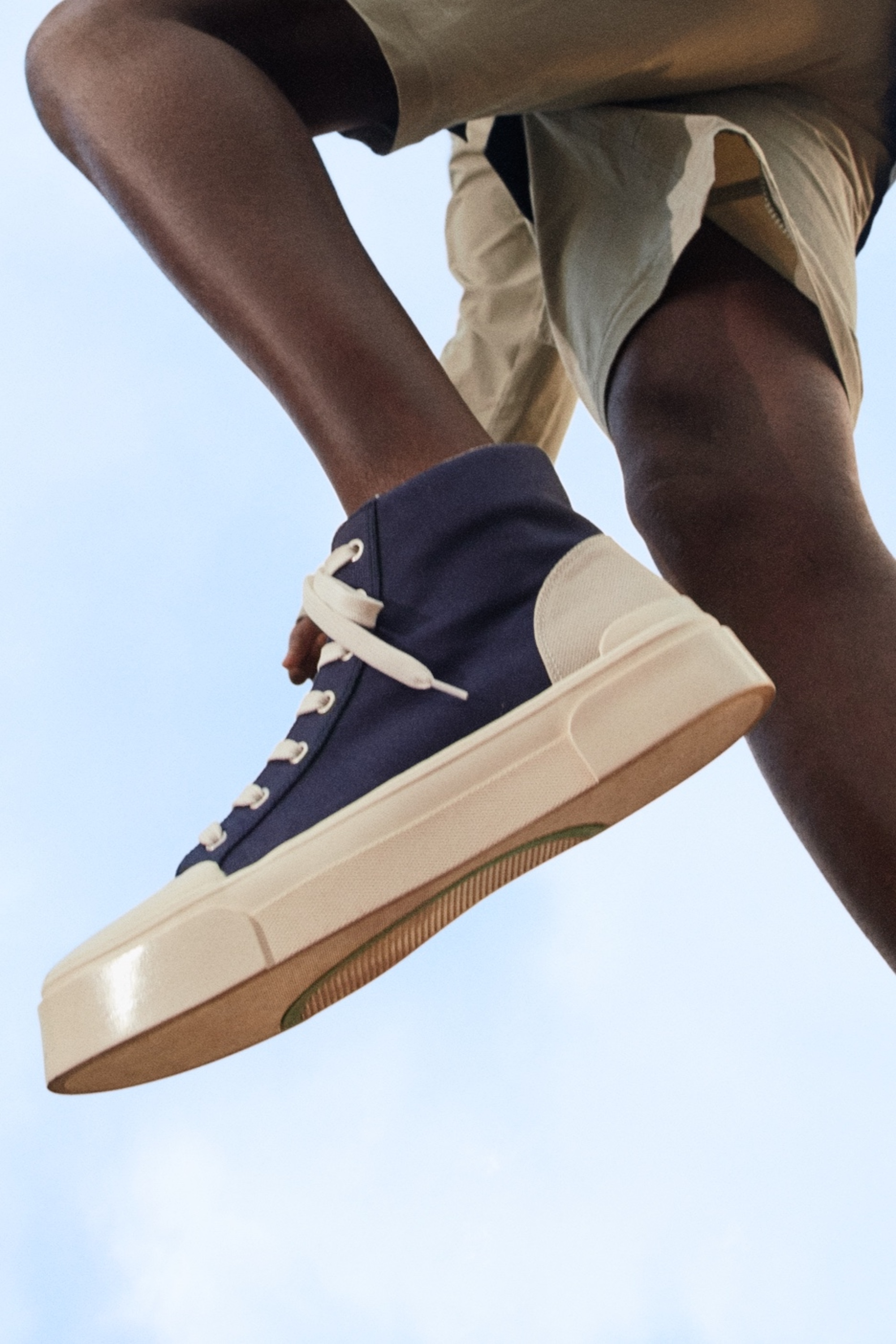 Good News x H&M collaboration navy sneakers